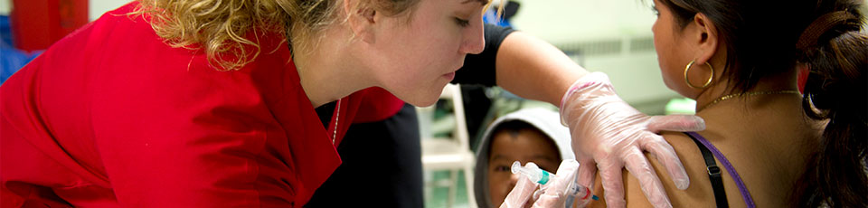 Rutgers School of Nursing-Camden student delivers flu shot at Camden clinic