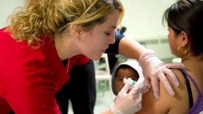 Nursing student delivers vaccine shot