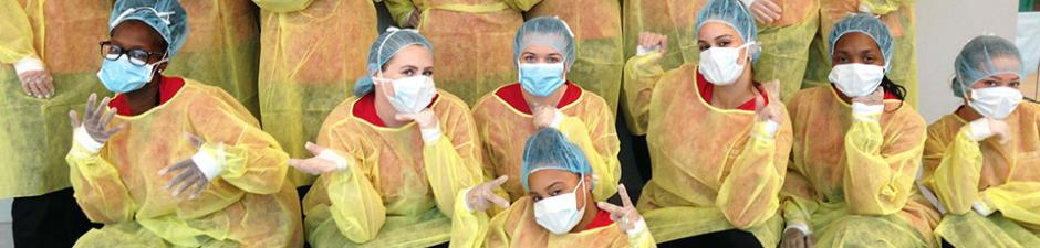 Rutgers-Camden Student Nurses' Association learns how to use PPE suits