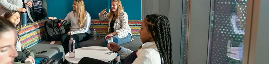 Nursing students review lecture in Nursing & Science Building lounge